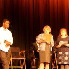 Allderdice Junior, Talon Scott, left, ready to lead the Pledge of Allegiance following opening words by Irene Habermann and Jessie Ramey