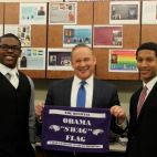 Pittsburgh Obama students, including panelist Joel Macklin (right) present Rob McCord with an official swag flag