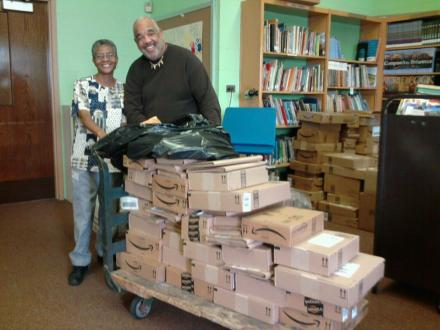 Mr. Wallace Sapp (right) helping to unload donated books during the Manchester Miracle.