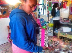 """Miyah made a great journal last week. high design if you'd have asked me. yesterday she came in. pulled last week's journal from her book bag. with the pages filled. she then went into production on a new journal.i remarked. you could be an entrepenuer. a young book maker. i went outside to work with some of the younger artists. when i came back in at the end of the evening. she had 5 new books laid out. creating masterful, colorfilled covers. and she is SOOOO quiet. she moves like a light wind from the east. remarkable."" – Vanessa German"